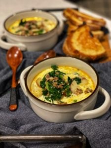 two white bowls of Zuppa Toscana soup