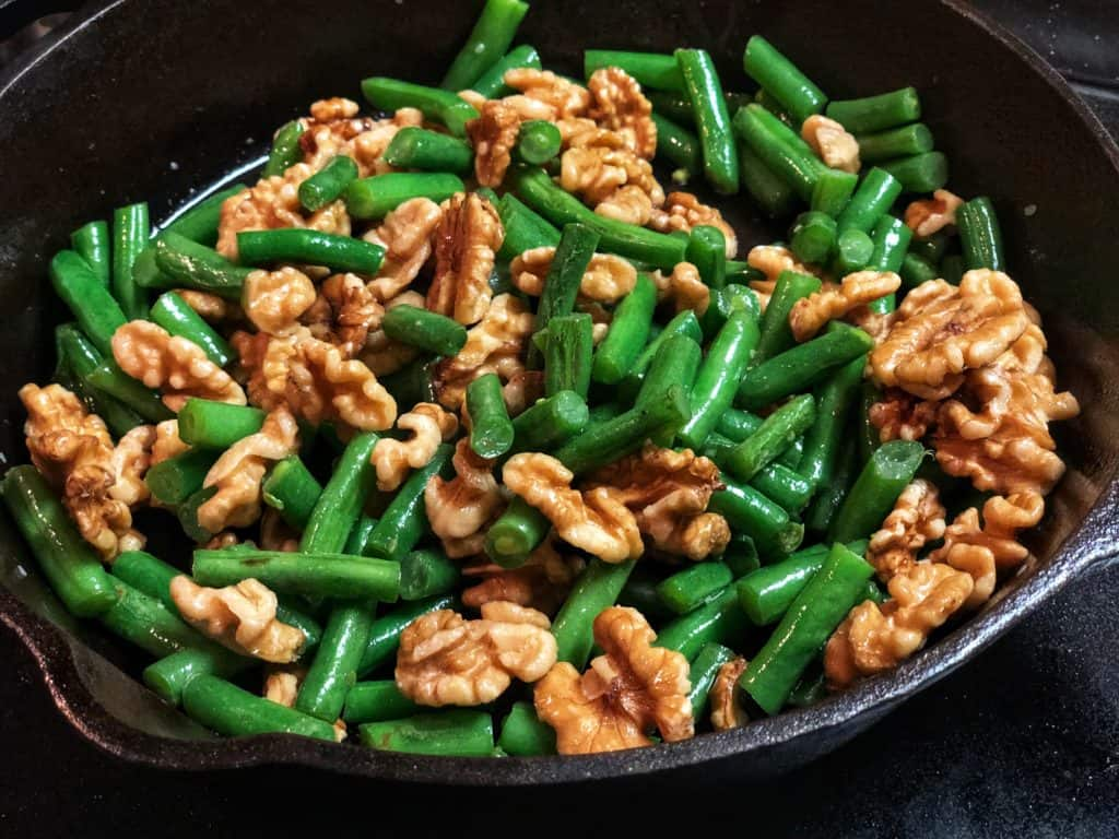 green beans and chicken in a cast iron for my spicy honey walnut chickenpan