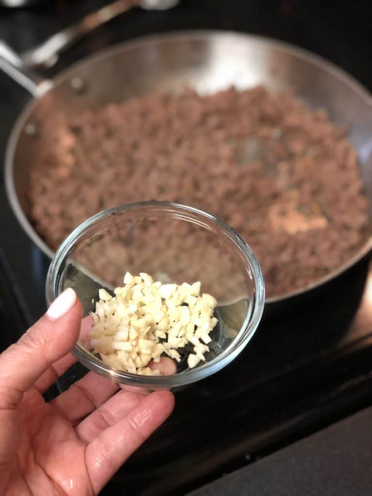 a bowl of chopped garlic