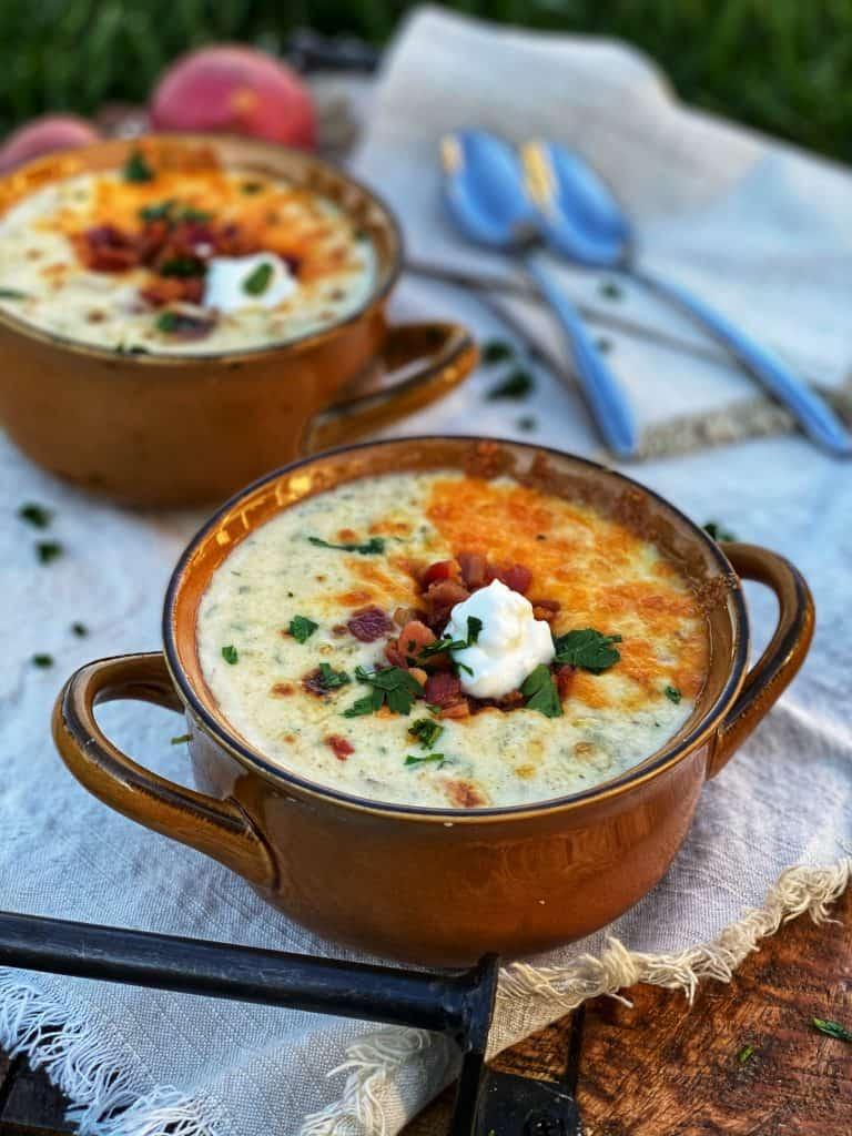 two brown crocks of loaded baked potato soup