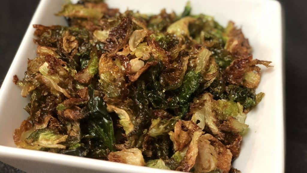 a bowl of fried Brussels sprouts