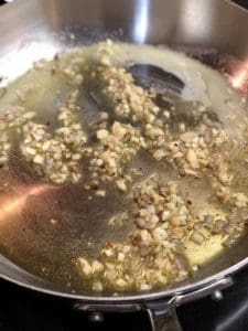 shallots and garlic with butter in a pan