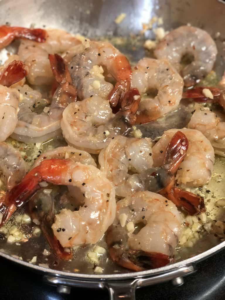 shrimp sautéing in garlic and butter