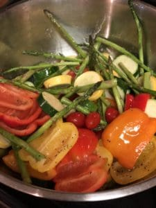 marinated vegetables in a stainless steel bowl