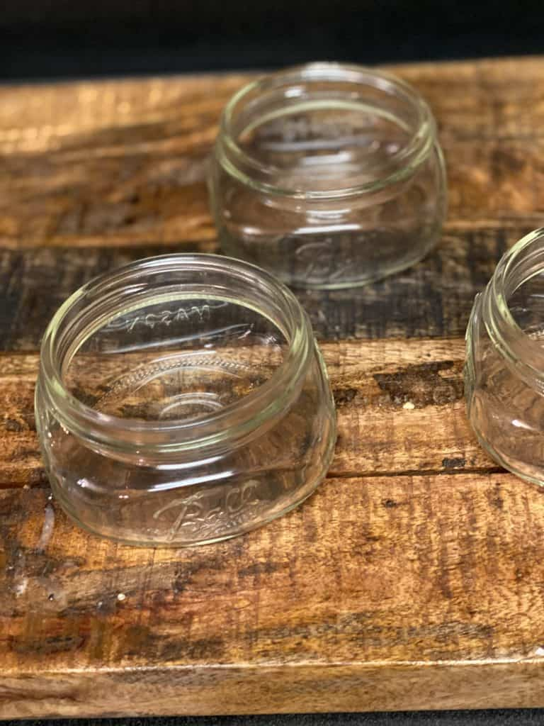 three 8 ounce mason jars on a woodenboard