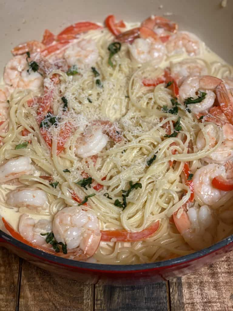 a pot of fettuccine with shrimp in a cayenne cream sauce