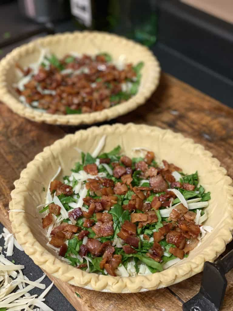 pie crust filled with bacon, spinach and Gruyere cheese