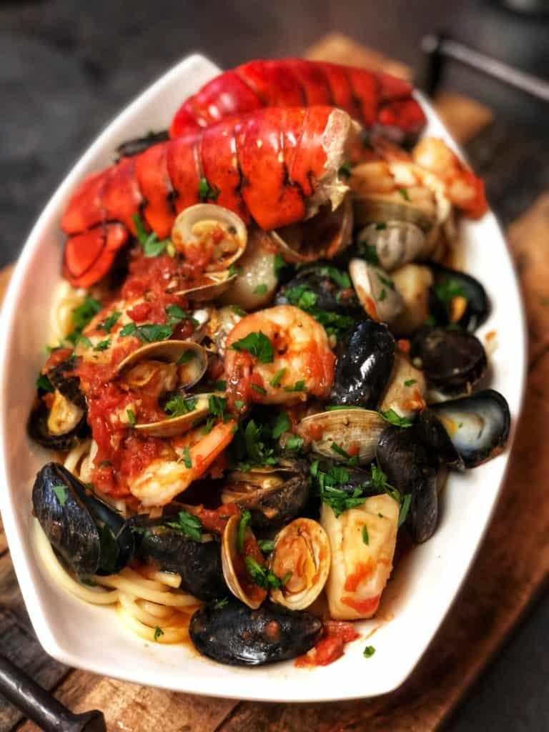 a big white bowl of seafood pasta fra diavolo