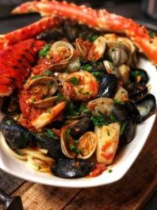 a white bowl of seafood pasta fra diavolo