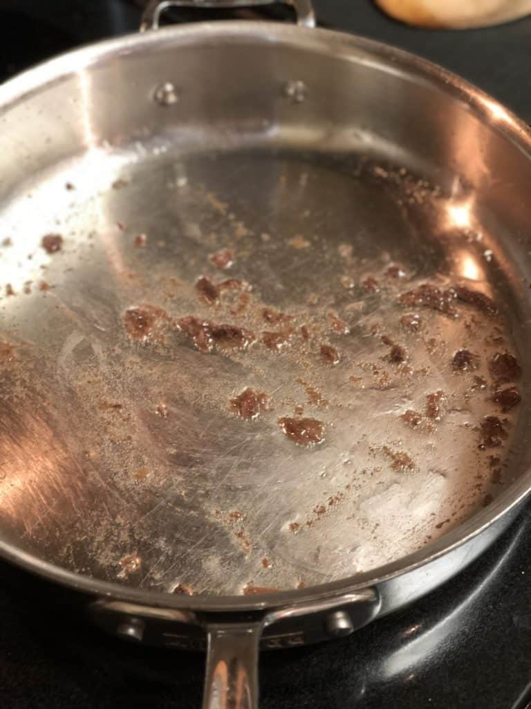 three anchovies cooking in a pan