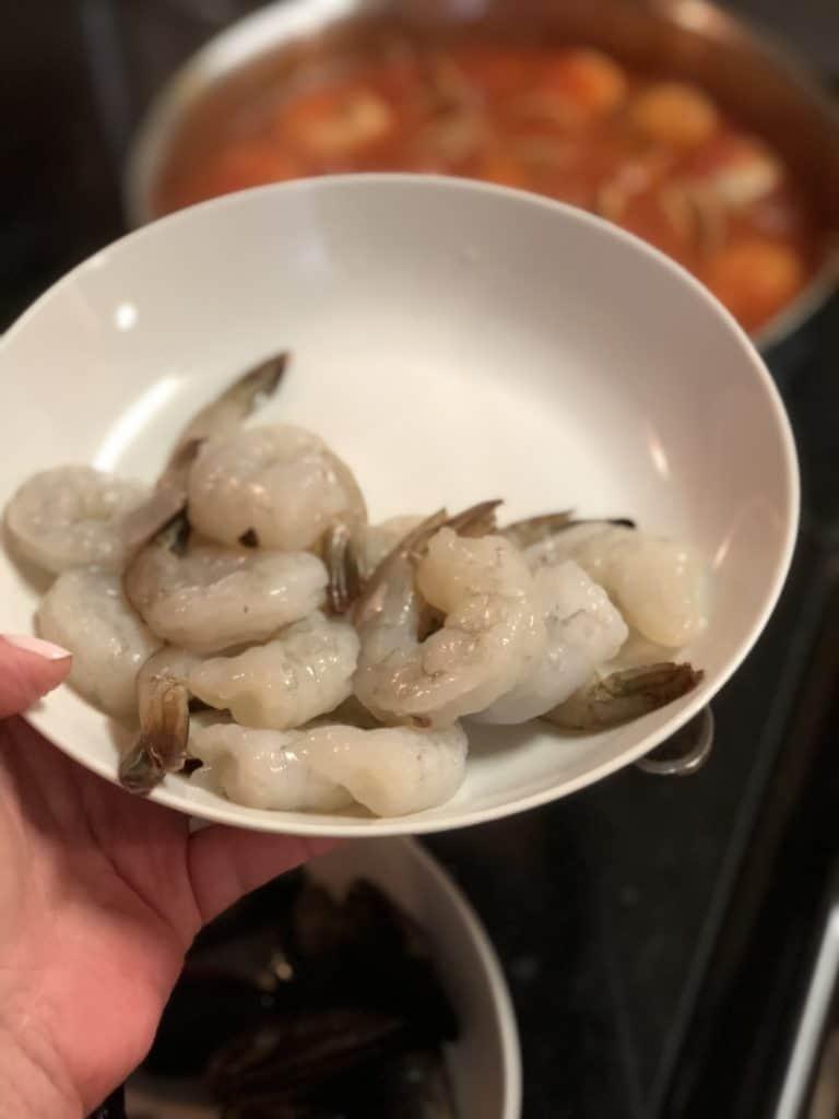 a white bowl of shrimp