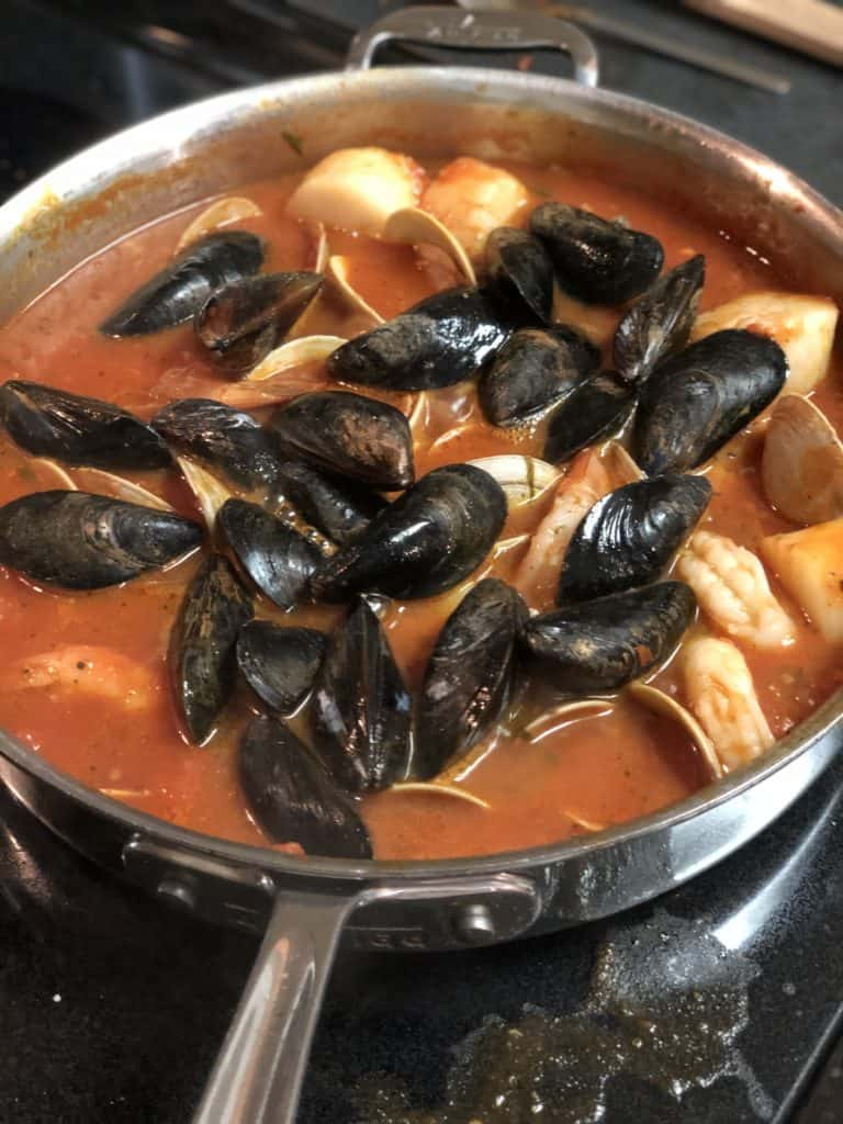seafood in a pan of sauce for my seafood fra diavolo