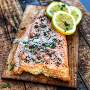 a piece Scottish salmon grilled on a cedar plank
