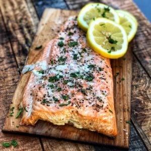 a piece Scottish salmon grilled on a cedar plank