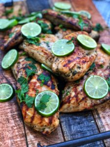 a wooden plate of cilantro lime grilled chicken