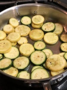a pan of yellow squash and zucchini slices cooking for my pasta primavera with shrimp
