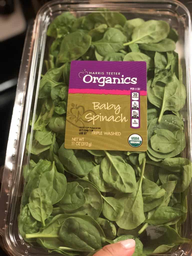 a container of baby spinach