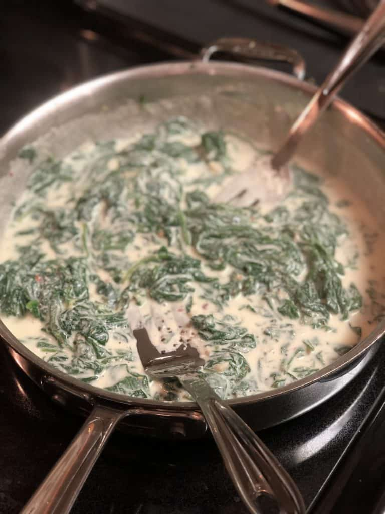 spinach ricotta pasta finishing in pan