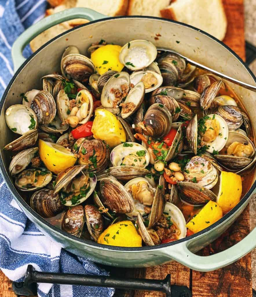 a pot of clams with sausage