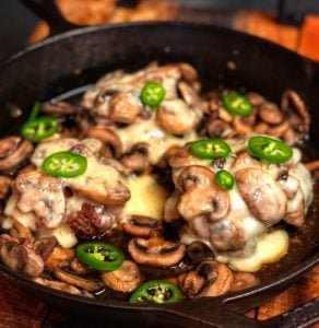 Gruyere Mushroom Burgers in a cast iron pan from Lodge