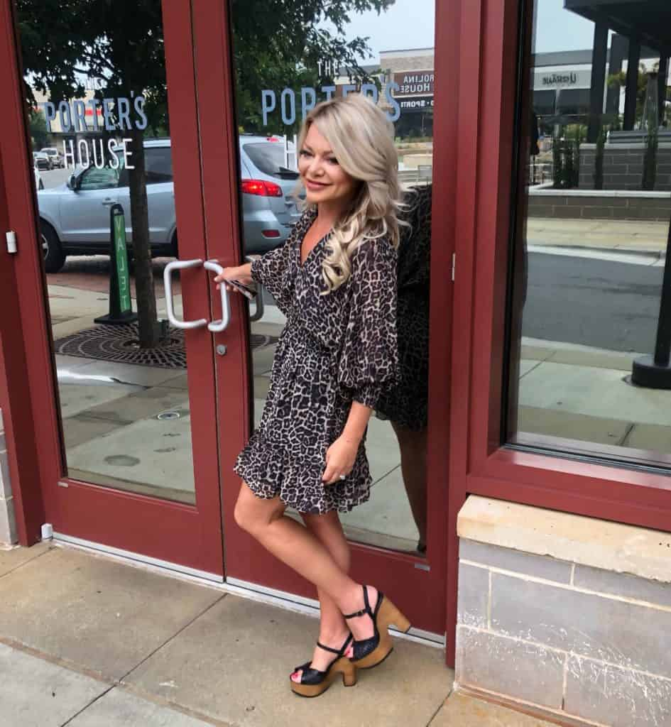 Me wearing a leopard print dress from Storia