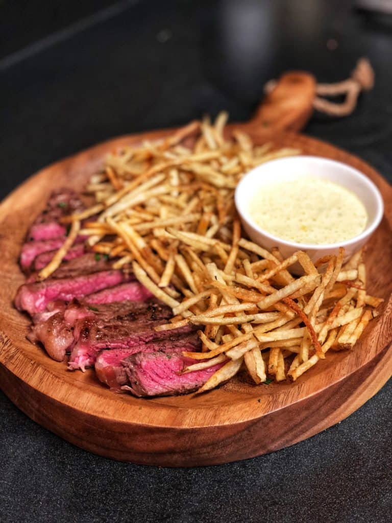 Sliced steak with fries and lemon aioli