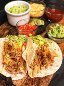Chicken Tacos in a soft flour tortilla with homemade guacamole