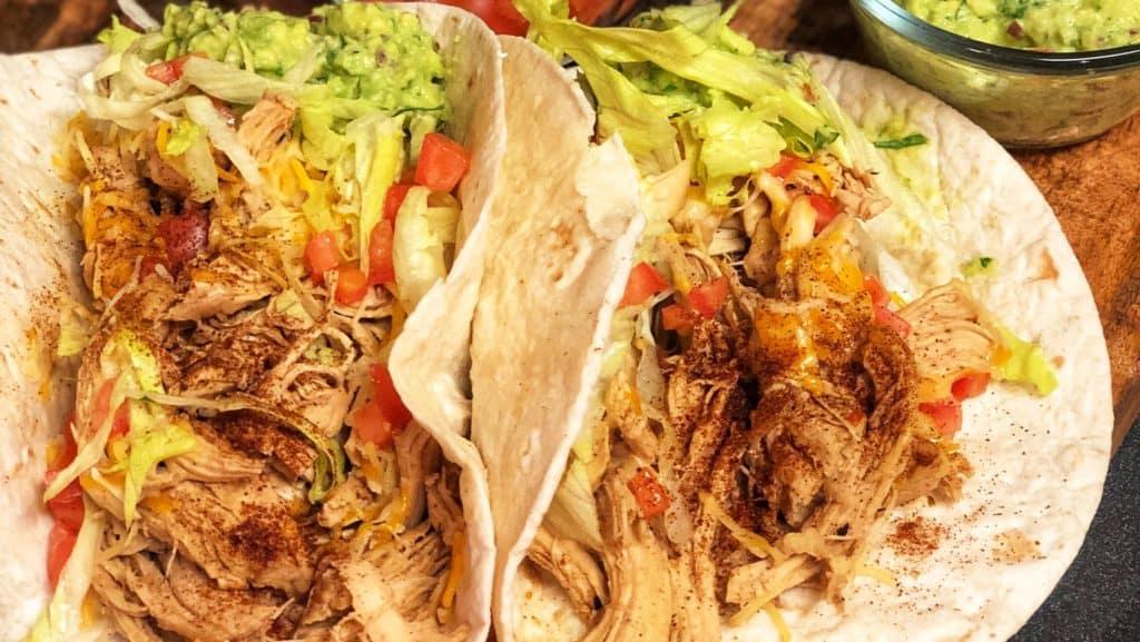 Chicken Tacos in a soft flour tortilla with homemade guacamole