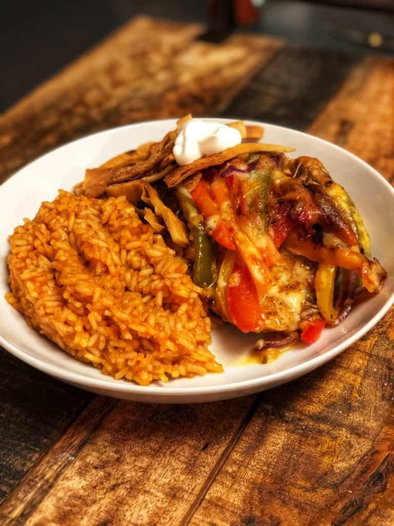 Chicken Fajita Casserole with Mexican Rice, crispy tortilla strips and sour cream