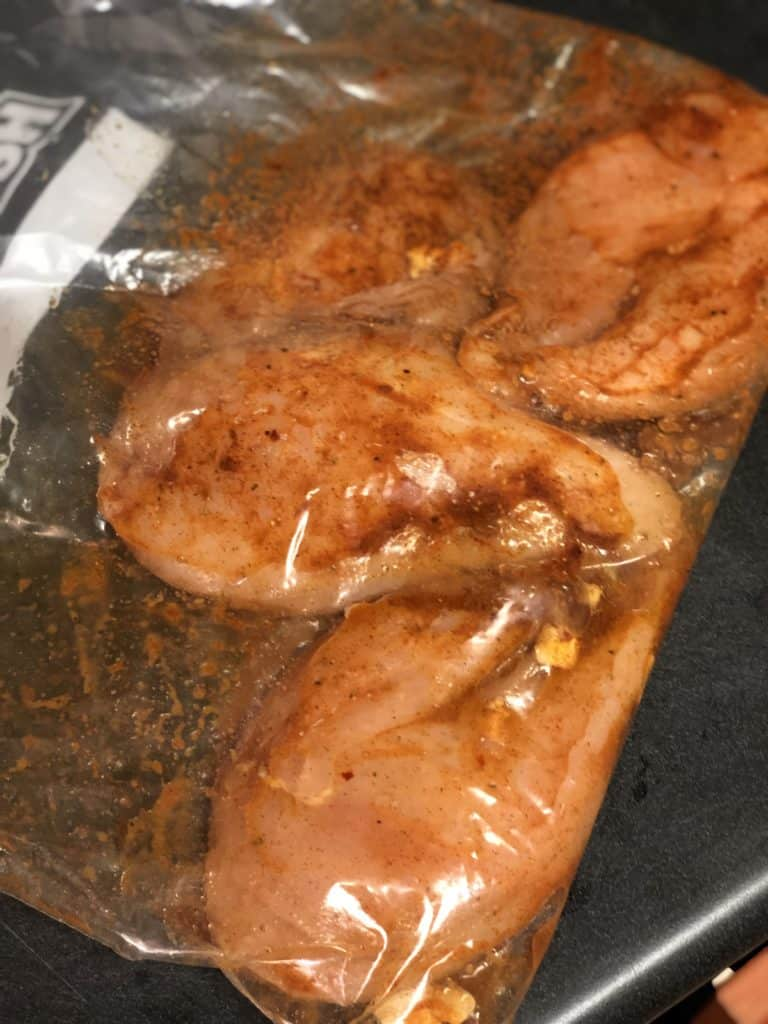 chicken fully coated in marinade for chicken fajita casserole