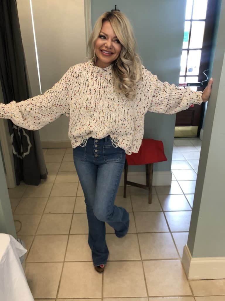me wearing jeans and a sweater