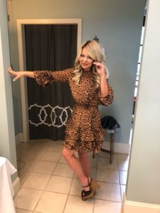me wearing an animal print dress