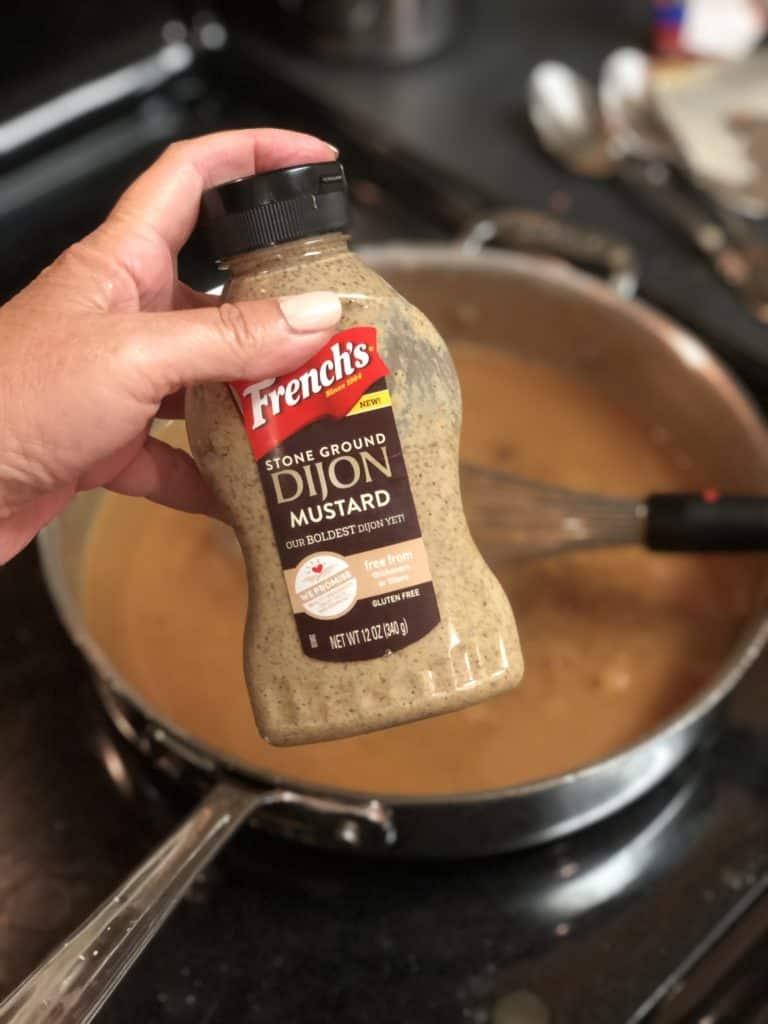 a bottle of dijon mustard
