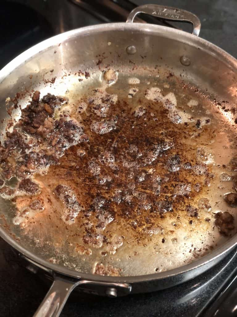 browned bits in a pan