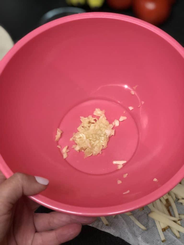 chopped garlic in a pink bowl