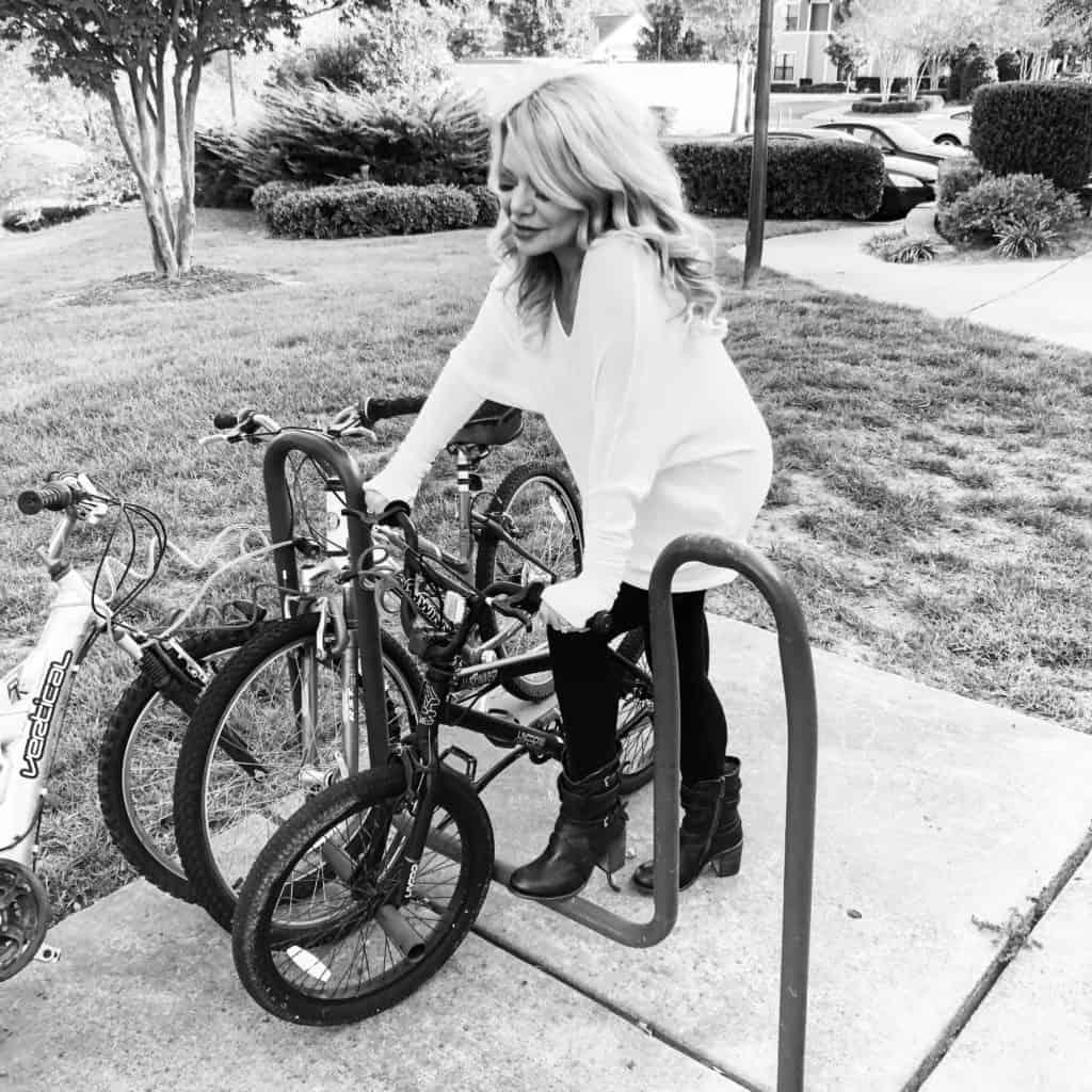 me wearing a maru sweater sitting on a bike