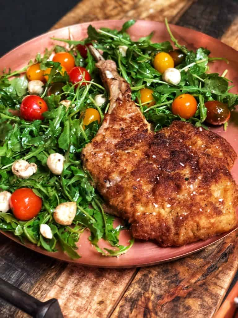 a plate of veal milanese