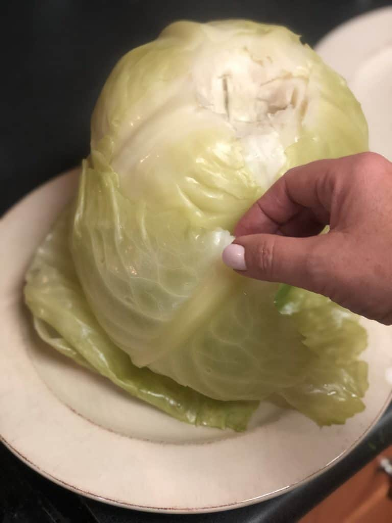 removing steamed cabbage leaves