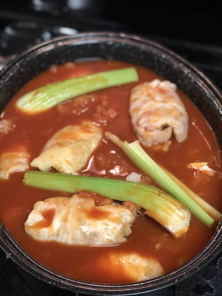 a roasting pan of cabbage rolls ready for oven