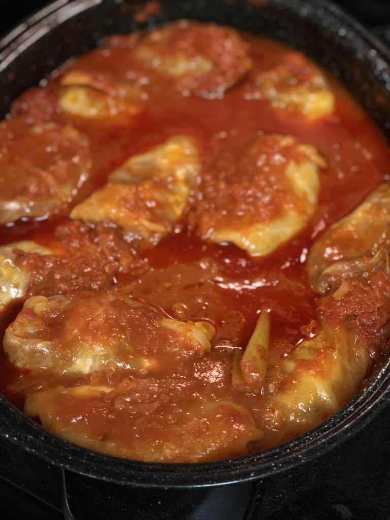 a roasting pan full of cabbage rolls