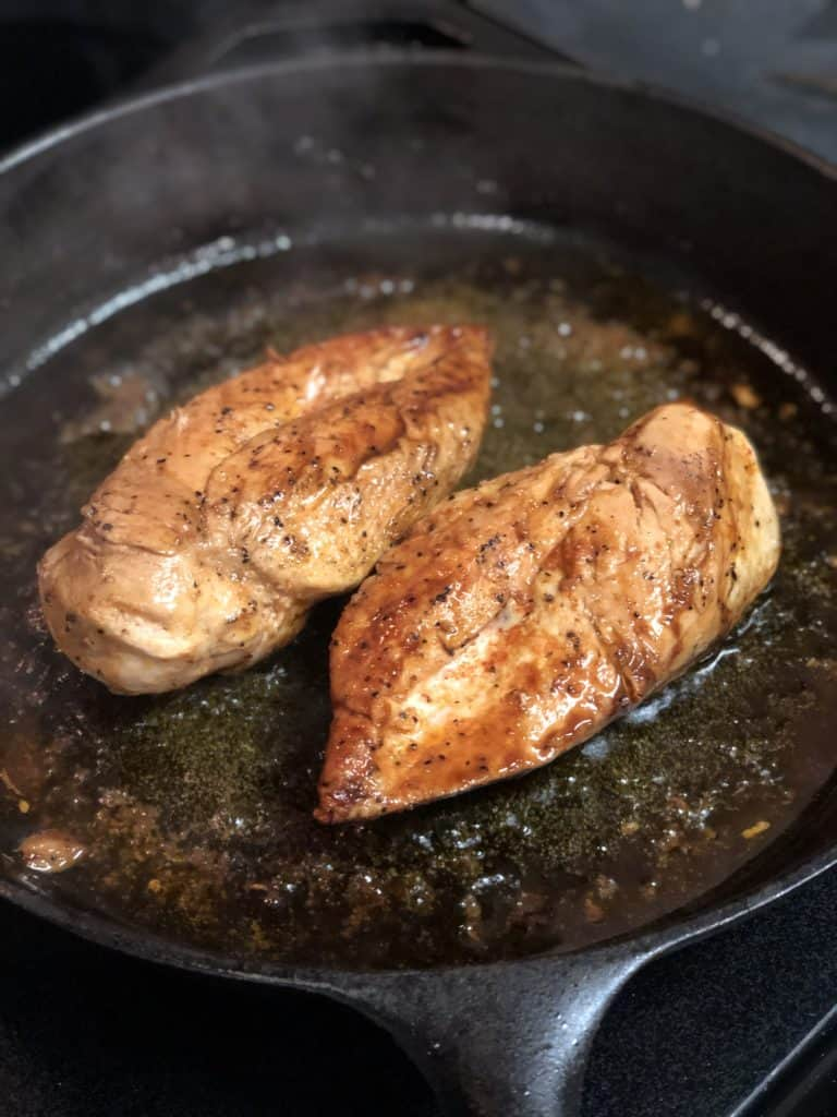 two chicken breasts seared in cast iron