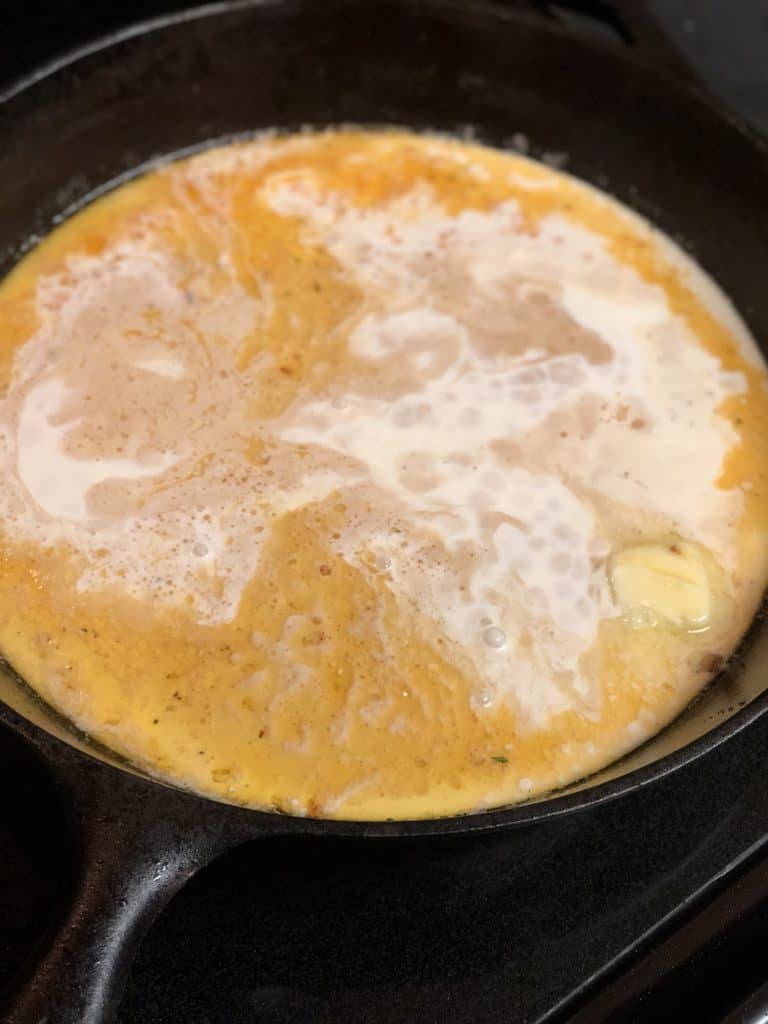 heavy whipping cream in a cast iron pan