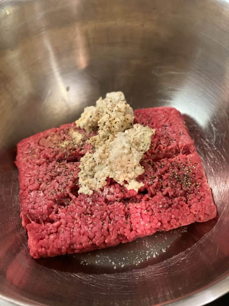 a bowl of ground meat with creamed soaked bread