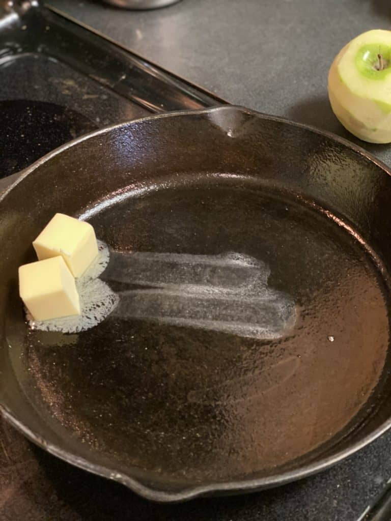 butter melting in a cast iron pan