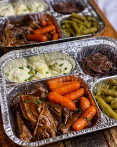 pot roast tv dinner with mashed potatoes, a brownie, and green beans