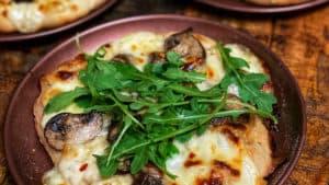 three mini mushroom pizzas