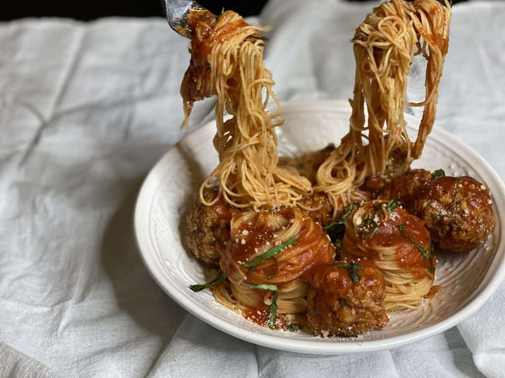 a bowl of spaghetti and meatballs