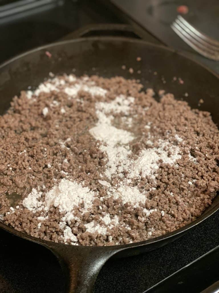flour sprinkled on cooked beef