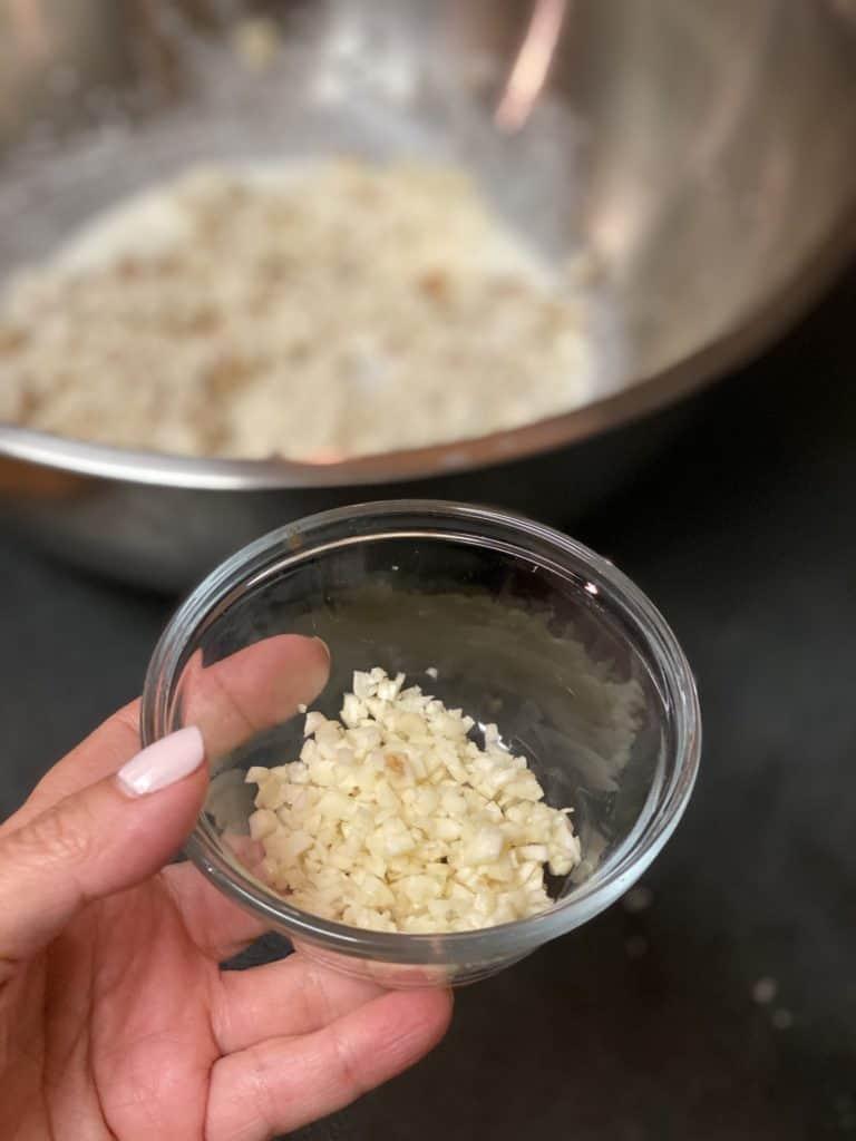 a bowl of minced garlic