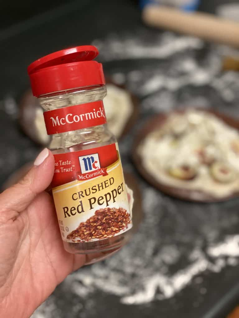 a bottle of McCormick crushed red pepper flakes